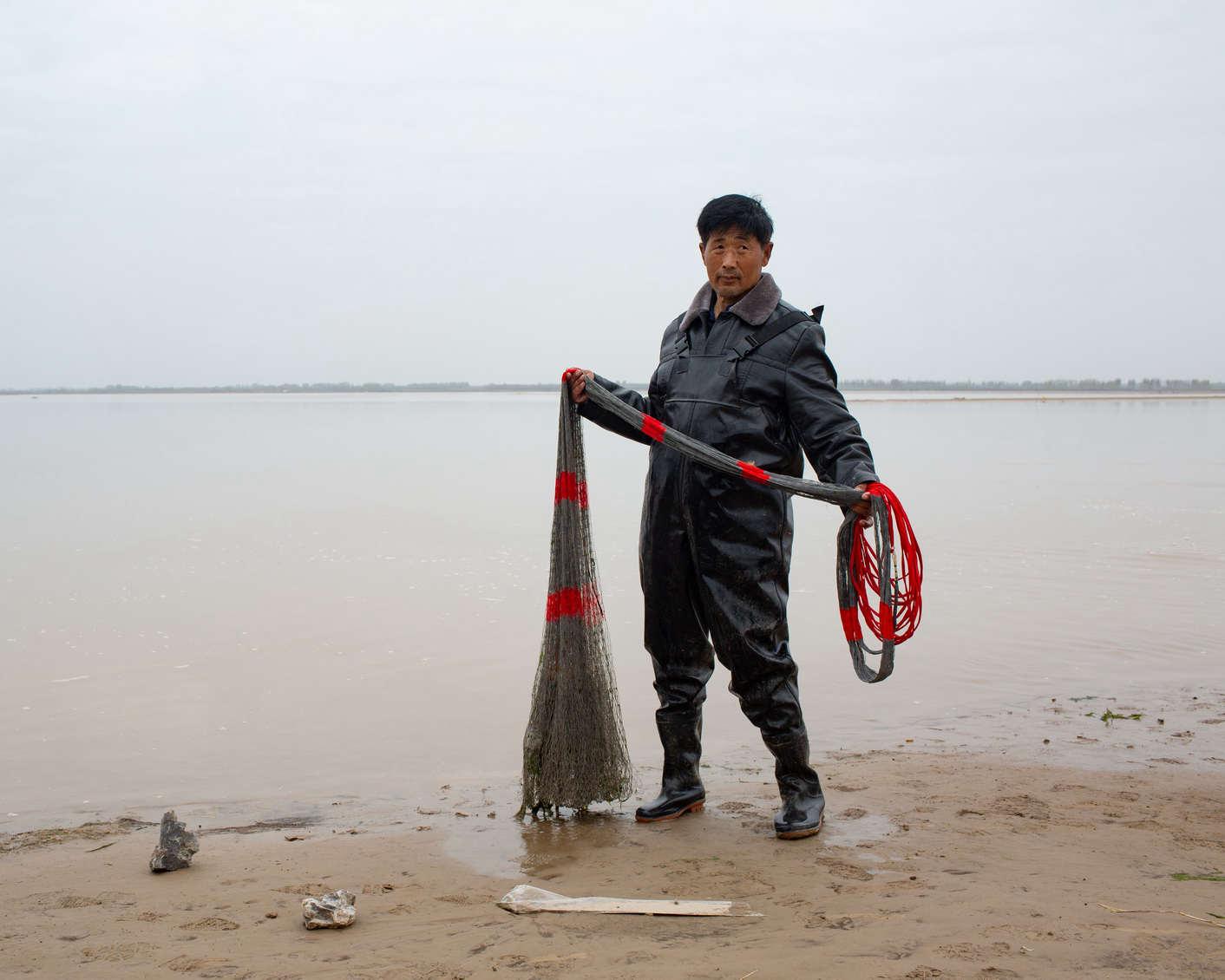12 新乡市原阳县,捕鱼的人,《黄河厚土》系列.jpg